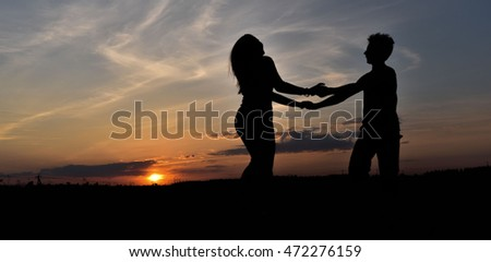 boy and girl at sunset