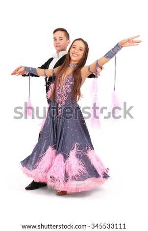 Boy and girl dancing ballroom dance on white background - stock photo