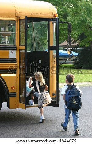 Boy and Girl Getting on Bus - stock photo