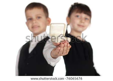 boy and girl giving ring in box isolated - stock photo
