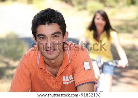 Boy and girl having a bike ride - stock photo