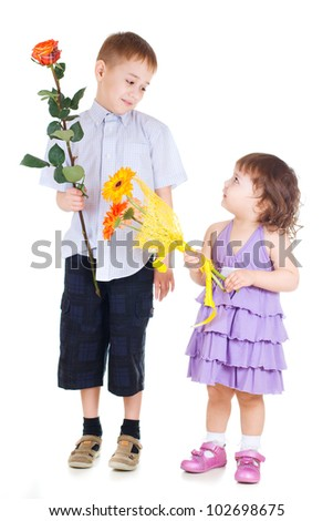 boy and girl holding flowers - stock photo