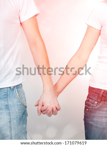 boy and girl holding hands - stock photo