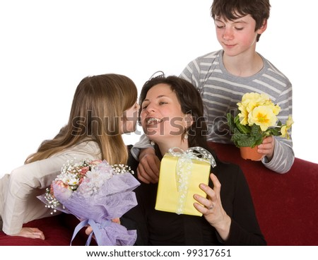 Boy and girl hugging their mother on mother's day - stock photo