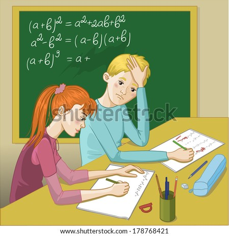 Boy and girl in a classroom - stock photo