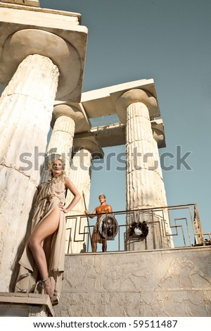 Boy and girl in columns - stock photo