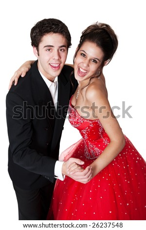 Boy and girl, in formal attire, dancing at their high school prom. - stock photo