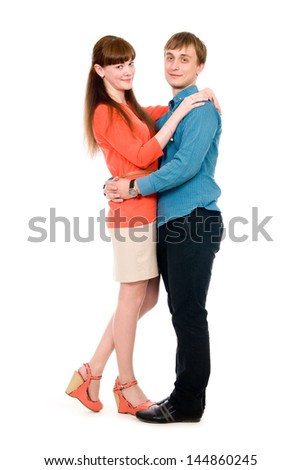 Boy and girl in love cuddling in full growth. Isolated on white background - stock photo