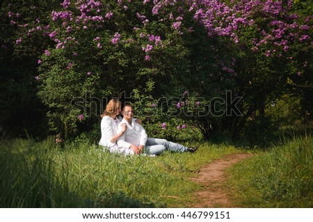 boy and girl in love in the park in the summer in a good mood