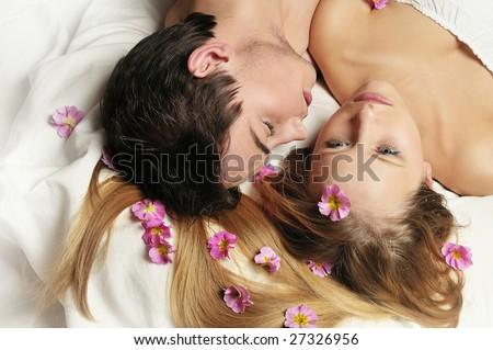 Boy and girl in love lying in the bed