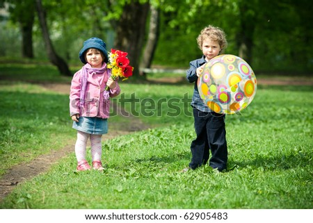 boy and girl in park - stock photo