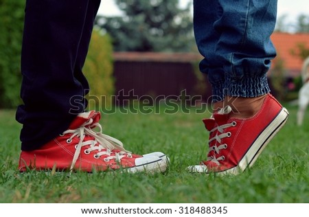 Boy and girl in sneakers - stock photo