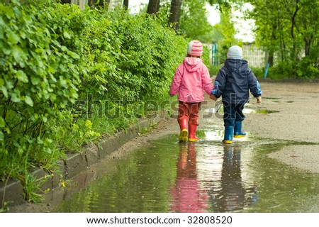 boy and girl in the puddle