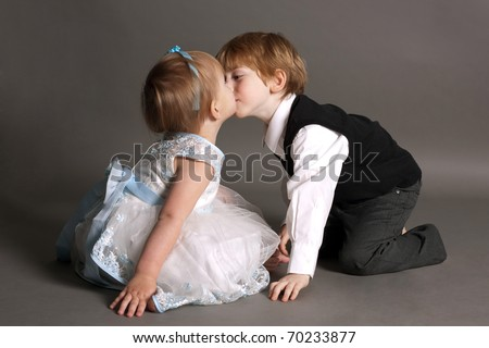 boy and girl kissing - stock photo