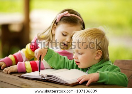 boy and girl learning - stock photo
