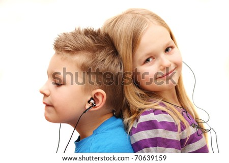 Boy and girl listening music, isolated on white background. - stock photo