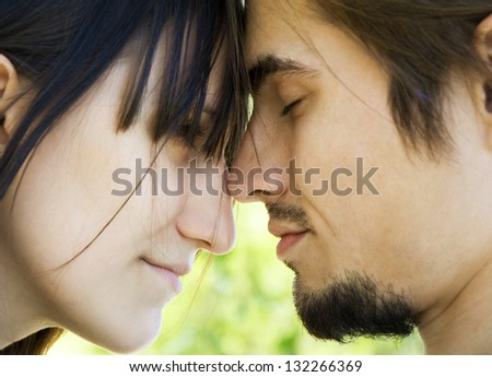 boy and girl look at each other - stock photo