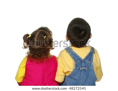 Boy and girl looking up, two and four years old, isolated on white background - stock photo