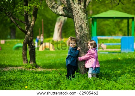 boy and girl on a playground - stock photo