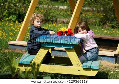 boy and girl on date on playground - stock photo