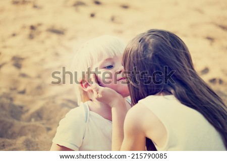 BOY AND GIRL ON THE BEACH - stock photo