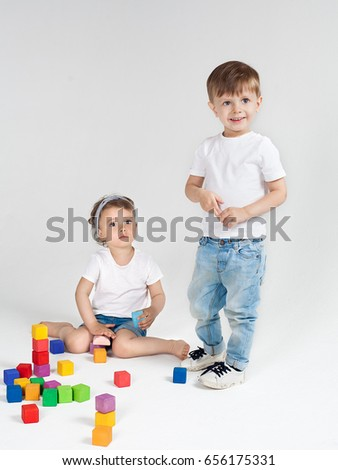 Boy and girl playing in colorful cubes