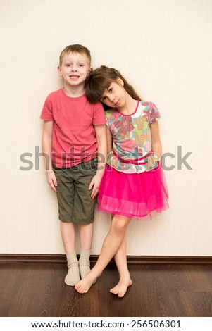 Boy and girl playing indoor - stock photo