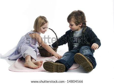 Boy and girl playing picnic