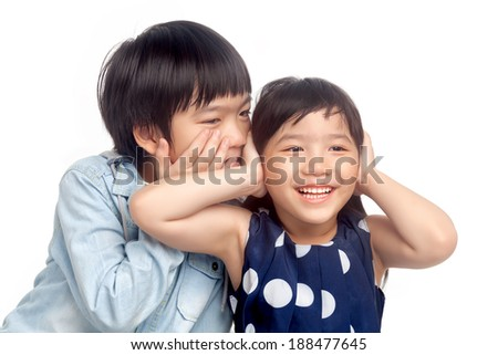 Boy and girl  playing together on white background - stock photo