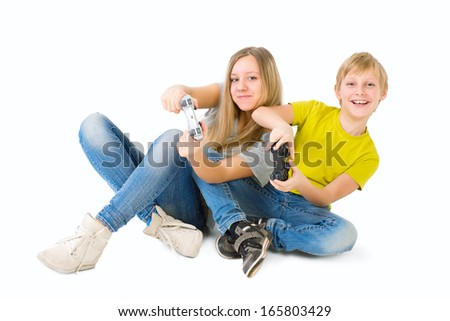Boy and girl playing video games - stock photo