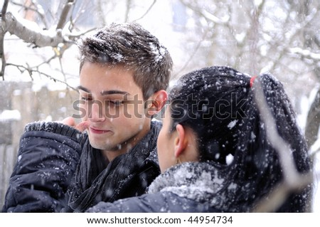 boy and girl playing with flakes - stock photo