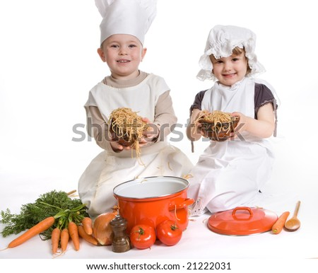 Boy and girl playing with spaghetti and food