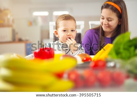 Boy and girl preparing and eating healthy meal