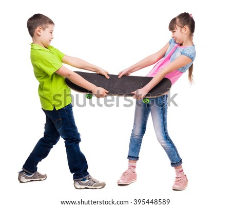 boy and girl pulling skate on sides - stock photo