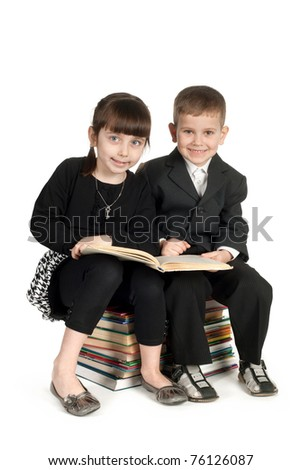 boy and girl reading book isolated - stock photo