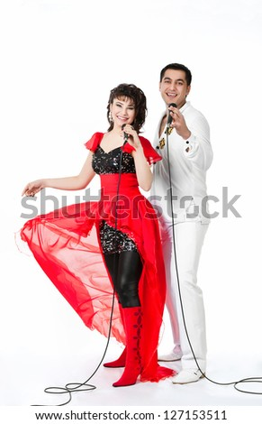 boy and girl singing together - stock photo