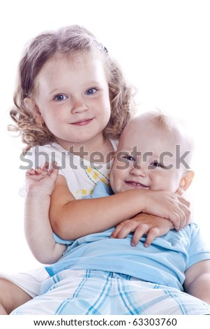 Boy and girl sitting on white background
