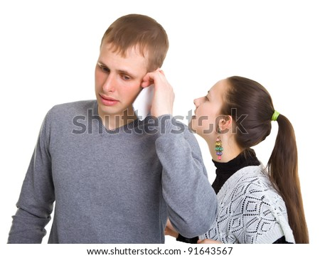 Boy and girl talking on a cell phone. Isolated on white background.