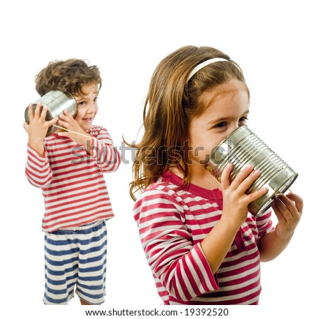 boy and girl talking on a tin phone isolated on white - stock photo