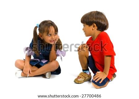 Boy and Girl talking on white background . - stock photo