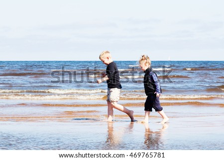 Boy and girl walking on beach