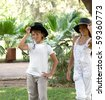 Boy and girl walking through the park. - stock photo