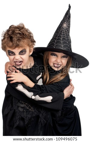 Boy and girl wearing halloween costume on white background