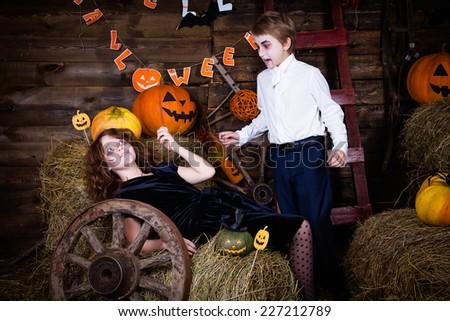 Boy and girl wearing halloween costume. Vampire and victim. - stock photo