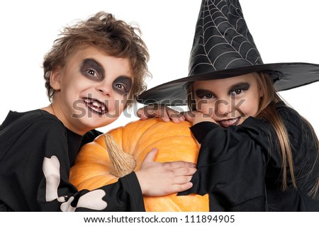 Boy and girl wearing halloween costume with pumpkin on white background - stock photo