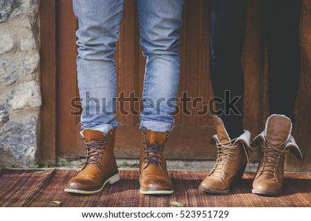 Boy and girl with fashion leather boots