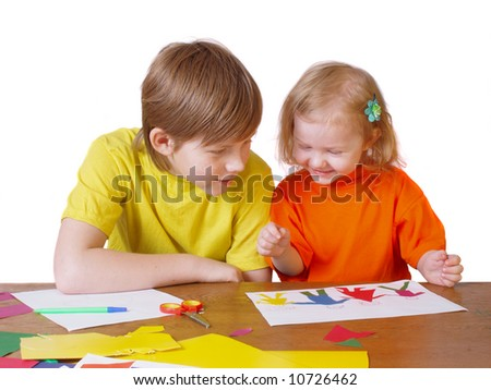 boy and girl with paper - stock photo