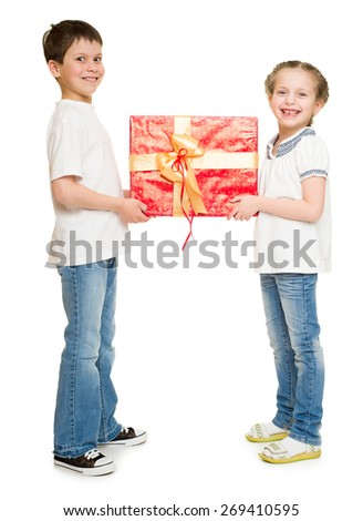 boy and girl with red gift box - stock photo