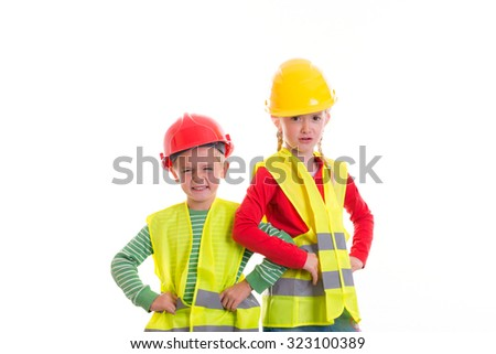 boy and girl with reflective vest and helmet in front of white background - stock photo