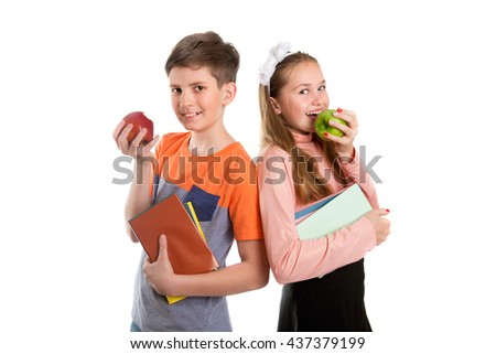 Boy and girl with tablet PC are eating apples, isolated on white background - stock photo